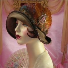 Fall colored hat with feathers and beading.