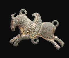 A SASSANIAN GILT BRONZE ATTACHMENT   Circa 5th-6th Century A.D.   In the form of a winged horse in profile to the left, in flight with the legs extended, the wing arching from the shoulder, the mane a series of incised lines, with three projecting loops for attachment