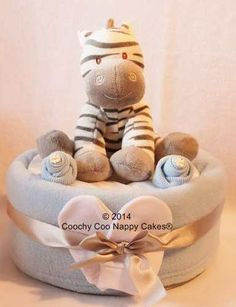 Large Plush zebra baby soft toy nappy cake for a baby boy! Baby shower gift idea or to send to a friend in the UK. £33.00 www.coochycoonappycakes.co.uk