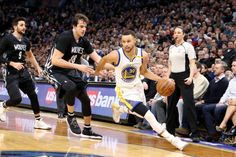 Stephen Curry of the Golden State Warriors handles the ball during the game against the Minnesota Timberwolves on March 10 2017 at Target Center in...