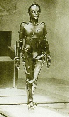 "What a fantastic robot design this is! From the Fritz Lang film, ""Metropolis"" a favourite of ours. Designed in the mid 1920s. This always struck us a female version of C3PO"