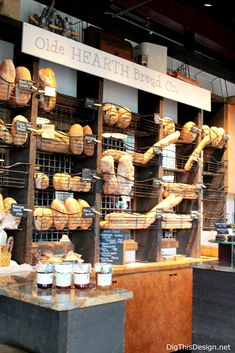 """Old Hearth Bread Co. at East End Market has a beautiful industrial rustic look with reclaimed """"look"""" metal wire basket shelving and dark grey reclaimed look wood cabinets. It's hard to resist this bakery's decor and smell of freshly baked bread Bread Display, Bakery Display, Catering Display, Catering Food, Bakery Decor, Bakery Interior, Bakery Shop Design, How To Store Bread, Bread Shop"""