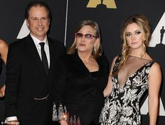 Fisher, who is now the only surviving child of Reynolds with her first husband Eddie Fisher, said the family is 'happy' that his mother is reunited with Carrie. Above he is pictured with Carrie and her daughter Billie in 2015