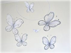 Butterfly baby mobile  Butterflies in silver by LullabyMobiles, $46.00  http://www.etsy.com/listing/75770872/butterfly-baby-mobile-butterflies-in
