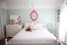 Lillie's room. Vintage bedding, colored chair and dresser knobs.