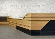 The same wood combines with blackened steel for the reception desk.Photography by Bruce Damonte.