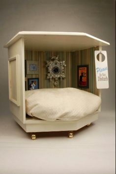 Fun DIY dog bed made from old nightstand. Loved the framed pictures