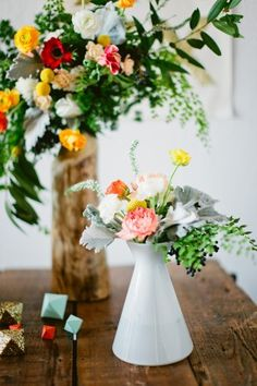 Modern Geometric Urban Wedding. Love the asymmetrical flowers. Very bright which i liked- not a muted palette