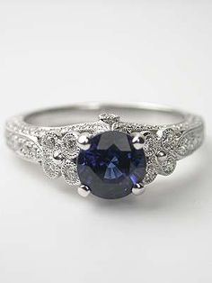 Blue Sapphire Engagement Ring, Love it,, love it more if it was topaz!