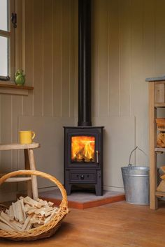 The Villager range from Arada Stoves are sturdy, reasonably priced steel stoves, with cast iron doors, flue spigots, grates etc. All of the Villager Timeless Classic range of stoves are fire bricked lined for longevity. A traditional wood burning stove. Wood Burning Stove Corner, Corner Stove, Corner Log Burner, Wood Burning Stoves, Kitchen Corner, Stove Fireplace, Country Fireplace, Small Fireplace, Wood Fireplace