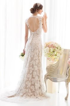 This open-back lace wedding dress is so romantic. Essense Of Australia, Spring 2014