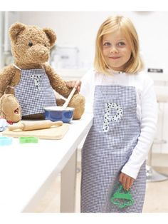 Sew a child's apron and one for her doll or teddy too. The link shows the pattern measurements in metric.