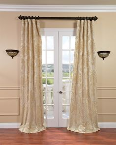 These faux-silk jacquard curtains add a touch of elegance to your living room, dining room, or anywhere you can hang a full-length window curtain. Each panel features a textured champagne pattern, and it is lined for durability and light filtration.