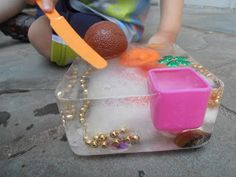 Ice blocks + tiny treasures = hours of fun with toddlers on hot summer days! Sure wish it was summer today!