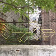 Find the hidden words - NYC string graffiti.