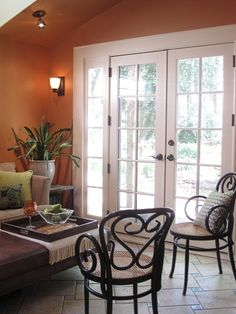 20 Trendy Dining Room Wall Colors to Transform Your Space Room Wall Colors, Dining Room Colors, Living Room Color Schemes, Dining Room Walls, Orange Paint Colors, Modern Paint Colors, Orange Color Schemes, Basement Living Rooms, Living Room Paint
