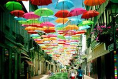 Perhaps the filter on these photos by Patrícia Almeida make these even more eye-catching, but we are showing you this because we think its a great idea for a public art project. In the town of Águeda, Portugal, colorful umbrellas are hung over promenades, giving your walk an interesting hue and something quite lovely to gaze up at.