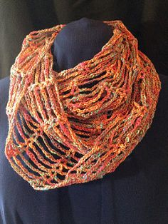 Celebrate the light and airy feeling of summer with this openwork cowl, its quick to crochet in a super simple pattern stitch. Wear it wrapped once around the neck for a long luxurious look or wrap it twice around to fill in a bare neckline. Requires 2 balls of Noema by Louisa Harding and a 4 mm crochet hook. Worked in the round, yay! No seams.