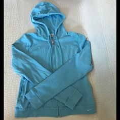 Nike zip up sweatshirt Pre-loved but kept in awesome condition !                                     ALL CLOTHING is either NWT or Preloved has been washed + sanitized then kept in a 🐾PET FREE and 💨SMOKE FREE environment .  too expensive , gonna break da bank ? Then add me to a 🛍 b u n d l e 🛍 or use the offer button   🗑 n o  l o w  b a l l i n g 🗑 REASONABLE offers accepted . I QUICKLY DECLINE OFFER requests like 40% below asking price .    🚫 🙅🏻 N O T R A D E S 🙅🏻 🚫 Nike Jackets…
