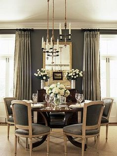 ~grey dining room ~chandeliers ~charcoal chairs, curtains, and walls