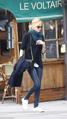 Cute and casual: The Prometheus actress was dressed down in leather trousers for her day o...