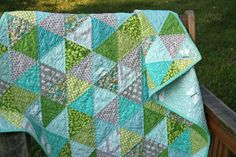 Baby Spring Triangle Quilt from film in the fridge. Love the colors, love the triangles, and love how she quilted it. I am going to have to grab up all my FQs and HYs and make one of these ASAP.