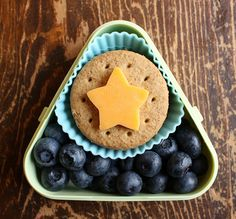 whole wheat crackers, some cheese stars (layered in between the crackers) and  blueberries.