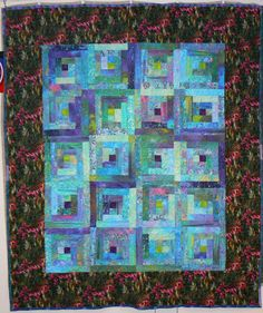 Batik fabric log cabin quilt- what is not to like about this?! Not a thing!