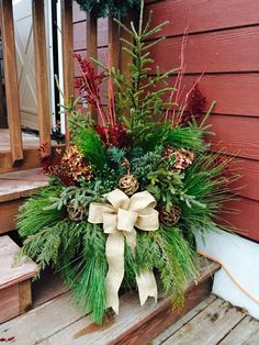 My spruce tip planter for my front porch this year. Love the textures.