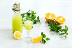 Home orange liquor in a glass and fresh oranges on the white wooden background stock photo (c) master1305 (#8290238) | Stockfresh