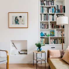 Living Room Design Ideas: Layout, Styling, Space, and Storage | Hunker White Bookshelves, Small Bookshelf, Built In Bookcase, Couch Storage, Living Room Storage, Cuddling On The Couch, Small Fireplace, Spacious Living Room, Interior Design Inspiration