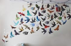 Print out some pretty bird silhouettes from the web and transfer it to a thick paper. Get some magazines with pretty backgrounds and trace. Cut out and paste on walls.