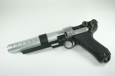 "The ""blaster"" given to Jyn Erso (played by Felicity Jones) in ROGUE ONE is a prop based on the frame and receiver of a Luger P.08 Parabellum pistol."