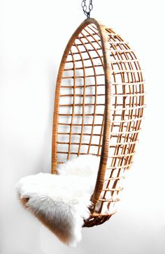 I love these vintage hanging rattan chairs, my Mom has a beautiful one that I have always admired!