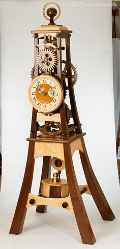 This is a wooden clock designed and built by Charles Maxwell, owner of Hardwoodclocks.com