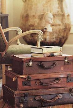 ♥ stack of suitcases!   Add maps as wall paper to a wall in this room and I might never leave it...
