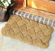 Call it traditional with a twist: Most outdoor mats are made from 100 percent coir, but the chunky weave of this one allows for excellent shoe-scraping ability—perfect for muddy fall days. About $19; Ballard Designs.