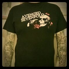 Avenged Sevenfold tee. The front has the band name with a revolver & sunglassed skull. The shirt has a solid black back. Tops Tees - Short Sleeve