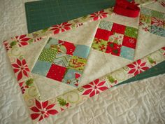 A Quilting Life: Scrappy 9-Patch Table Runner Tutorial ~ A cute and simple table runner! Perfect for mini charms! The possibilities are endless with a large selection of mini charms and other precuts to choose from at the Fabric Shack at http://www.fabricshack.com/cgi-bin/Store/store.cgi