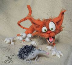 crazy funny cat and hedgehog
