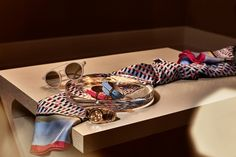 A soft silk scarf and sparkling accessories for her