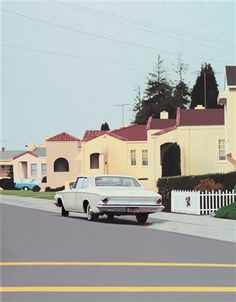 Robert Bechtle oil on canvas.  Bechtle has focused our attention on the everyday. Working in a sun-bleached color palette and photorealist style, Bechtle gives us a quiet Americana: street-scapes, family scenes, portraits of cars. Bechtle works from photographs of familiar subjects (his family and home, for example), creating a record of a precise moment while withholding just enough detail to remain painterly. The result is an uncanny reflection of middle-class American culture.