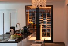 wine cellar - sleek! And right off the kitchen? Awesome