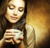 Beautiful Woman with cup of Coffee Royalty Free Stock Photos