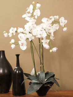 Linen White Tall Silk Orchid Design O106-76. Large, dazzling white array for a crisp, clean home décor.  Oriental, but works as a nice office or lobby piece too. One of our favorites.