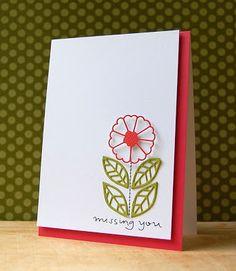 Flor roja hojas verdes