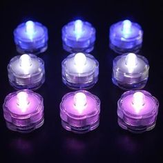 Waterproof LED Decor Tea Lights are a bright way to illuminate centerpieces, floral vases or ice bowls. Submersible LED Water Lights are reusable and waterproof. Small Led Lights, Vase With Lights, Blue Led Lights, Lighted Centerpieces, Submerged Flower Centerpieces, Centerpiece Ideas, Vase Fish Tank, Wedding Vases, Wedding Reception