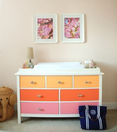 Fun Nursery Idea: Personalize Dresser/Changing Table by painting drawer fronts for a pop of color!