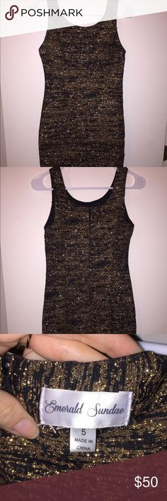 Sparkly Gold Bandage Dress This dress is awesome! Black underlay with gold spun thread running through it. It's the bandage type of dress and it zips up in the back. NWOT. Emerald Sundae Dresses Mini