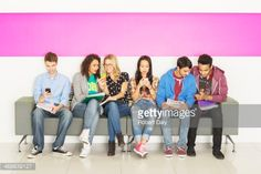 Stock Photo : University students sitting on bench